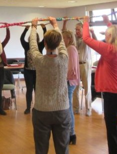 CPD workshop teachers lifting rope together