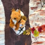Squirrel puppets in a painted tree multisensory days 2021